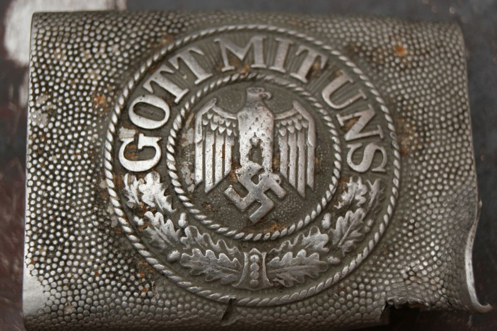 Battle damaged GJR belt buckle